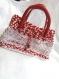 Sac à mains réalisé en trapilho (tissu recyclé) rouge et blanc.