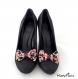 Clips chaussure noeud noir fleuri rose et pois.