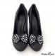 Clips chaussure noeud rockabilly noir à pois blanc.