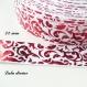 Ruban gros grain blanc arabesque rouge effet brillant de 22 mm vendu au mètre