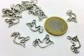 X1 breloque - colombe paix solidarité - en metal argenté