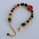 Bracelet tendance peace and love heishi noir orange