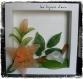 Cadre floral avec des fleurs en nylon orange