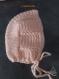 Gilet et bonnet rose saumon pour bébé