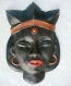 Masque africain en céramique, ciré