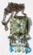 Collier sautoir en bronze avec perles de verre vertes bleues et transparentes ornées d'une fleur blanche
