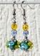 Parure argentée avec collier et boucles d'oreilles à fleurs assorties en lampwork et en relief