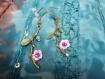 Boucles d'oreilles et sa branche fleurit