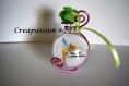 Contenant à dragée boule en plexi thème fée clochette rose fushia et vert anis