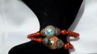 Bracelet orange réalisé en perles de renaissance et perles acryliques