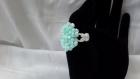 Bague fleurettes réalisée avec des perles de swarovski vertes claires