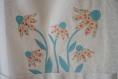 Tablier xxl, en toile de coton écru de qualité avec appliqué de fleur.