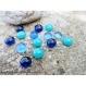 15 billes de verre fondu multicolores aux formes variables...
