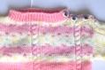 Pull bébé à motifs rose et blanc tricoté main taille 12 mois
