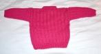 Pull bébé à motifs rose fuchsia tricoté main taille 12 mois