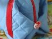 Couverture enfant accompagnee de son sac a doudou