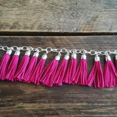 Bracelet pompons fushia
