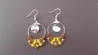 Boucles d'oreilles dorées motif ethnique