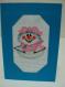 Carte de voeux brodée au point de croix: bonhomme de neige souriant