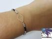 Elza - bracelet perle de rocaille argentées et noires et losange argenté