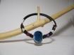 Bracelet noir fantaisie avec une petite perle céramique raku