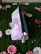 Trousse triangulaire violette et vert d'eau.