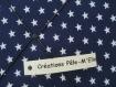 Pêle-mêle photos sur tissu bleu marine à étoiles blanches. esprit scandinave.