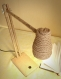Wooden desk lamp with a wooden base and an abat-jour made of a jute rope