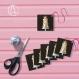 Lot de 12 étiquettes cadeaux «pièce montée » illustrées d'une pièce montée de mariage ou de baptème couleur pastel sur fond noir
