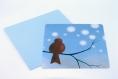 Carte postale «zouik» illustrée d'un rouge-gorge sur une branche sous les flocons