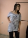 Elegant ladies tunic with a large neckline and fringes on the back
