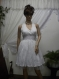 White ladies dress with bare back of fine white wrinkled cotton dress with crinoline, lace waist