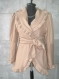 Beige coat with gold facial crucibles