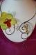 Collier en fil d'aluminium chocolat et perles de verre nacrées avec son orchidée anis