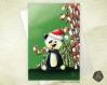 Carte de voeux noël nouvel an fêtes de fin d'année bébé panda et sucres d'orge