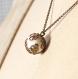 Collier confidence - chaîne fine bronze, pendentif en agate blanche