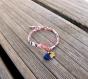 Bracelet enfant, tissu liberty wiltshire pois de senteur, petit lapin et pompon bleu marine