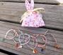 Bracelet en tissu liberty b vert céladon pour enfant, petit lapin et pompon rose pastel