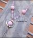 Unique collier pendentif chaîne en métal argenté et perles acryliques rose 34x110mm 66cm