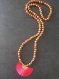 Sautoir bohème chic avec pompon rose fushia corail