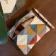 Porte-carte motif géométrique bleu orange et gris