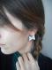 Boucles d'oreilles nœuds de cuir argent.