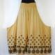 Pantalon ample papillon en viscose beige, imprimé motifs ethniques noirs , élastiqué à la taille