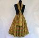Jupe mi- longue à motif ethnique jaune et multicolore, ceinture élastiquée à la taille