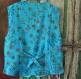 Gilet sans manches homme bleu turquoise à motifs brodés en coton