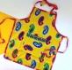 Tablier de cuisine enfant jaune et rose fuchsia en coton motifs paisley