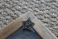 Breloque en forme d'étoile couleur bronze