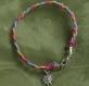 Bracelet tressé bleu orange et rose ,breloque soleil en metal argenté