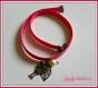 Bracelet double en tissu rose avec breloques couleur bronze