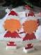 Petite poupée de noël en papier découpé - rousse
